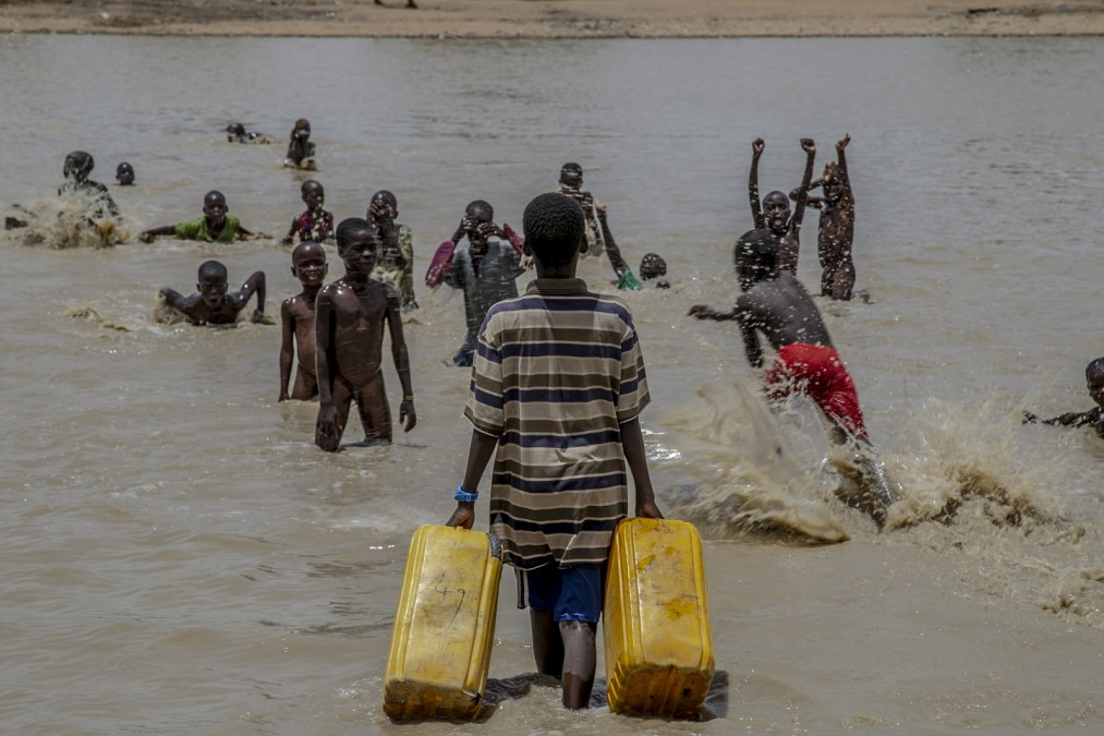 Children play in a pond of water created after heavy rains in Pulka town. Nigeria, May 2018. © Igor Barbero/MSF