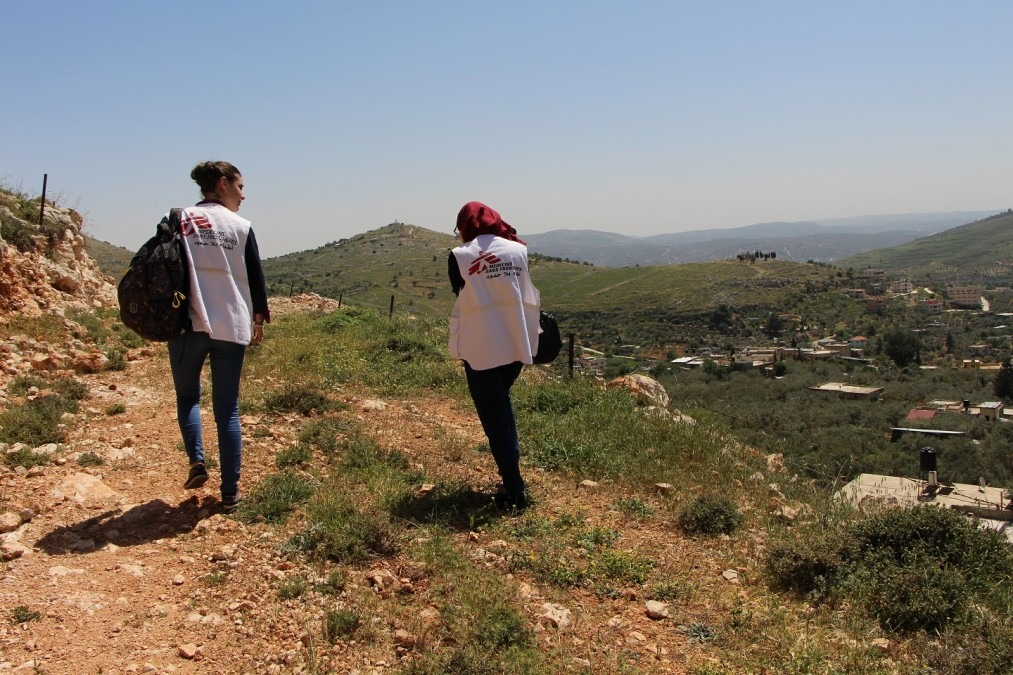 MSF psychologist and translator go meet a patient in Burin village. Some villagors live in remote area and are afraid to leave their house to go to MSF clinics because of settlers attacks. West Bank, April 2018. © Laurie Bonnaud/MSF